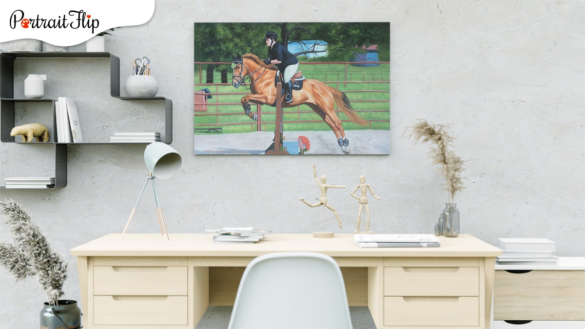 A galloping horse portrait above office desk.