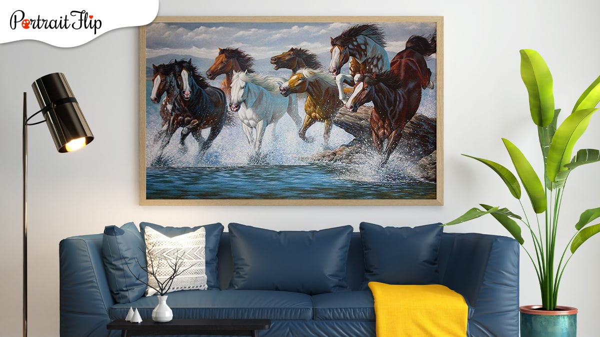 Eight horse portrait in a living room. The living room has blue sofa with tree on one side and a amp on the other.