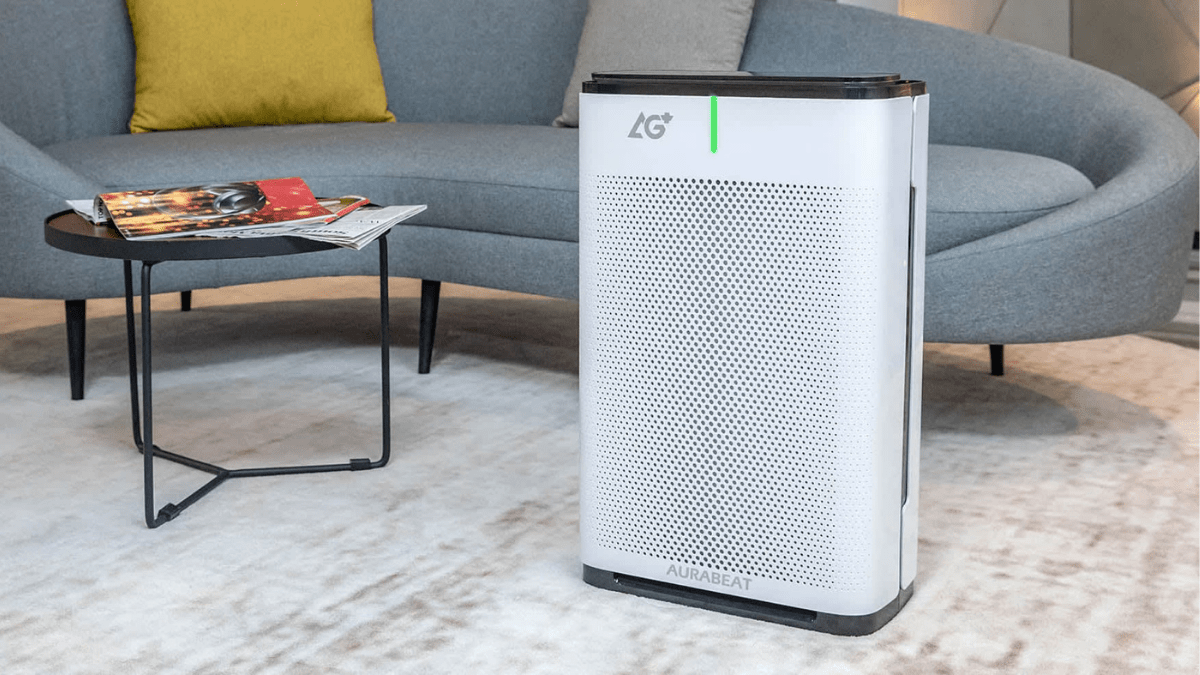 white colored air purifier cleaning the living room