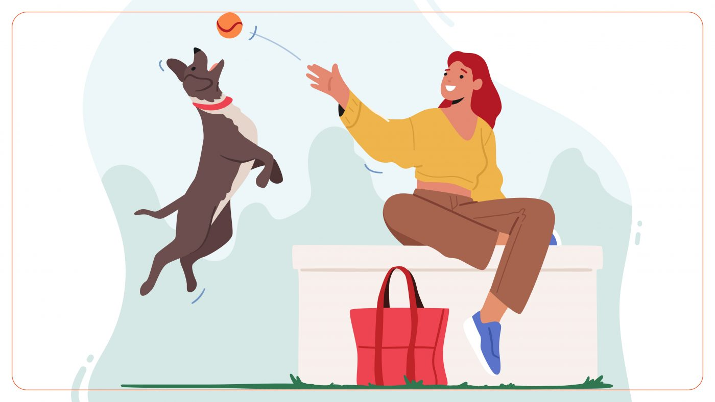 A woman throwing ball towards her dog to fetch it. The background is blue with a red bag kept on the ground.