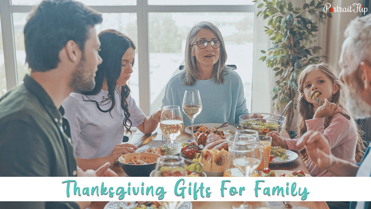 thanksgiving gifts for family: a family dining together and chatting