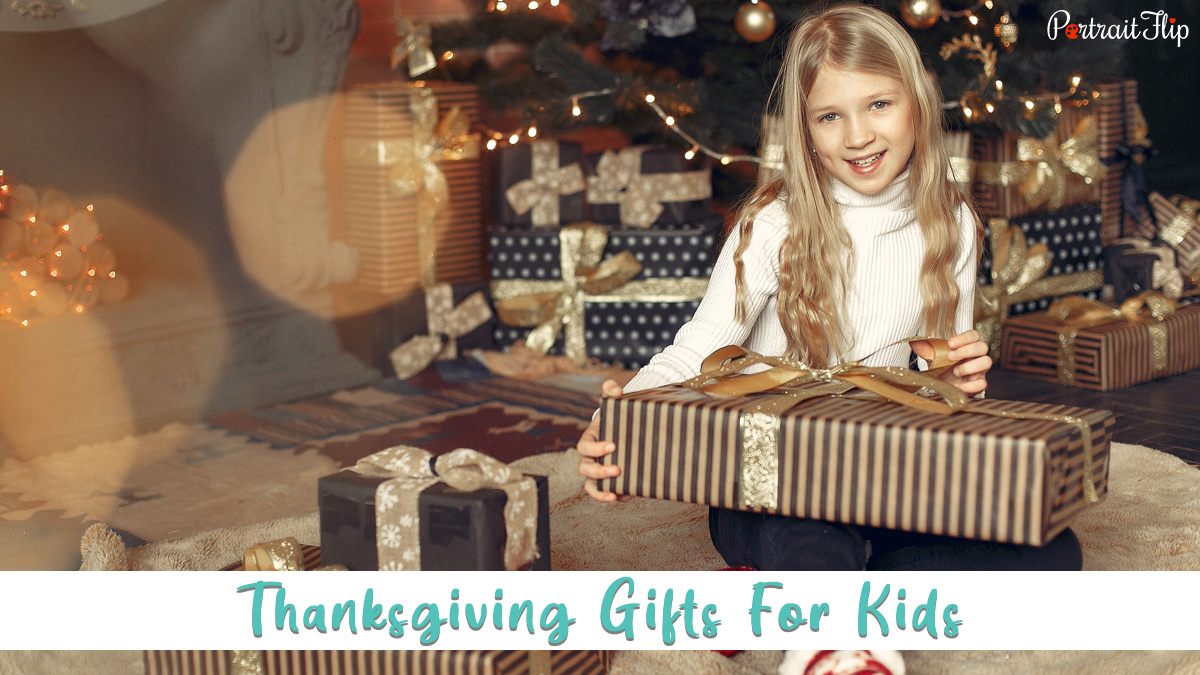 a kid holding thanksgiving gift in her hand