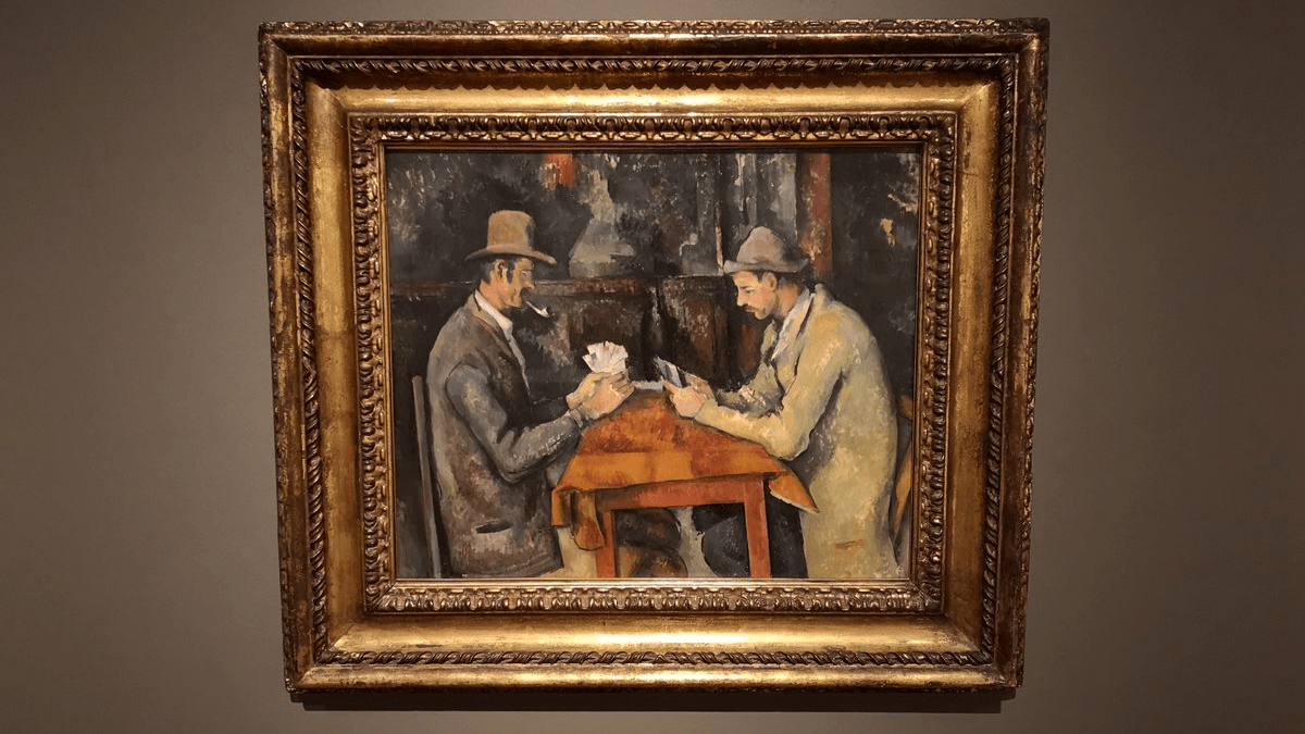 The artwork 'The Card Players' by Paul Cézanne - one of the most expensive paintings displayed with golden and bronze frame.