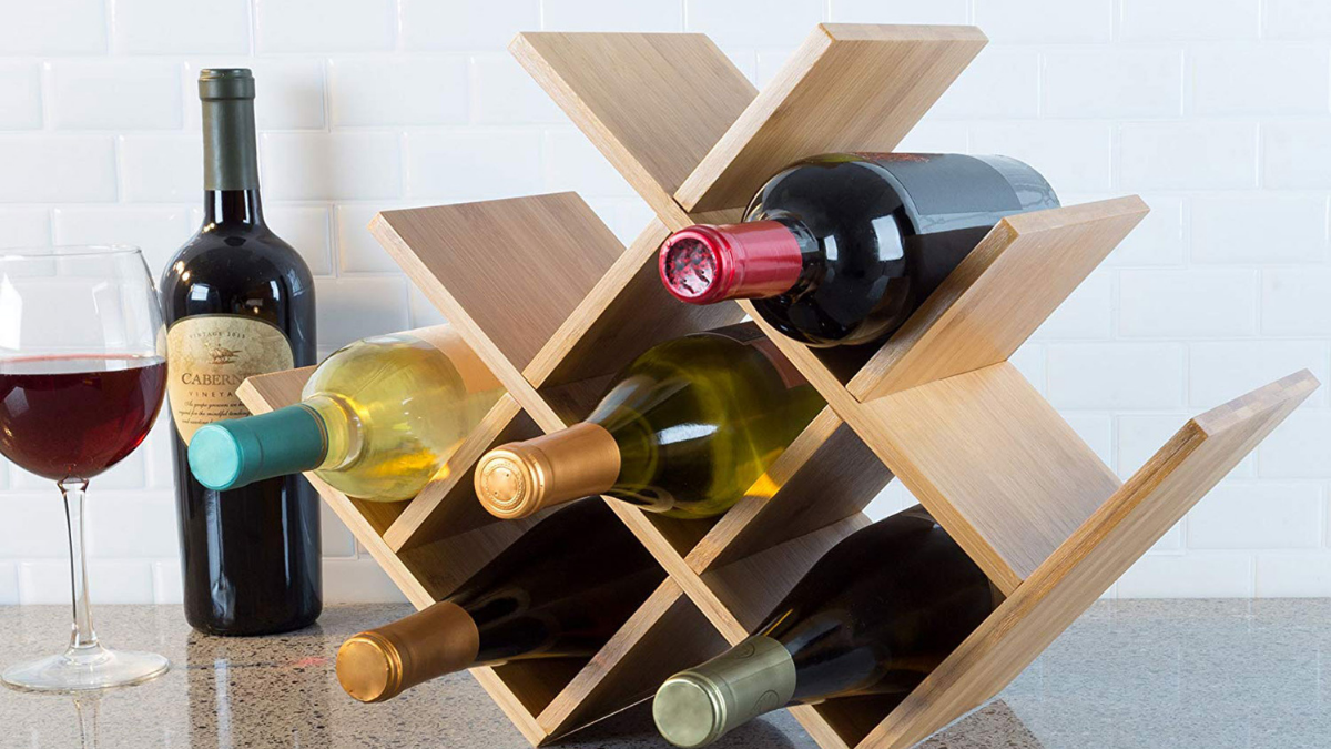 a wooden wine rack with wine bottles