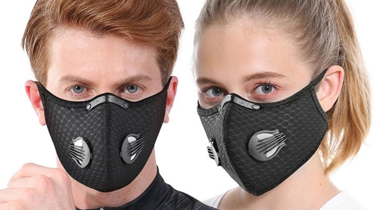 A man and woman wearing black colored antiviral face mask