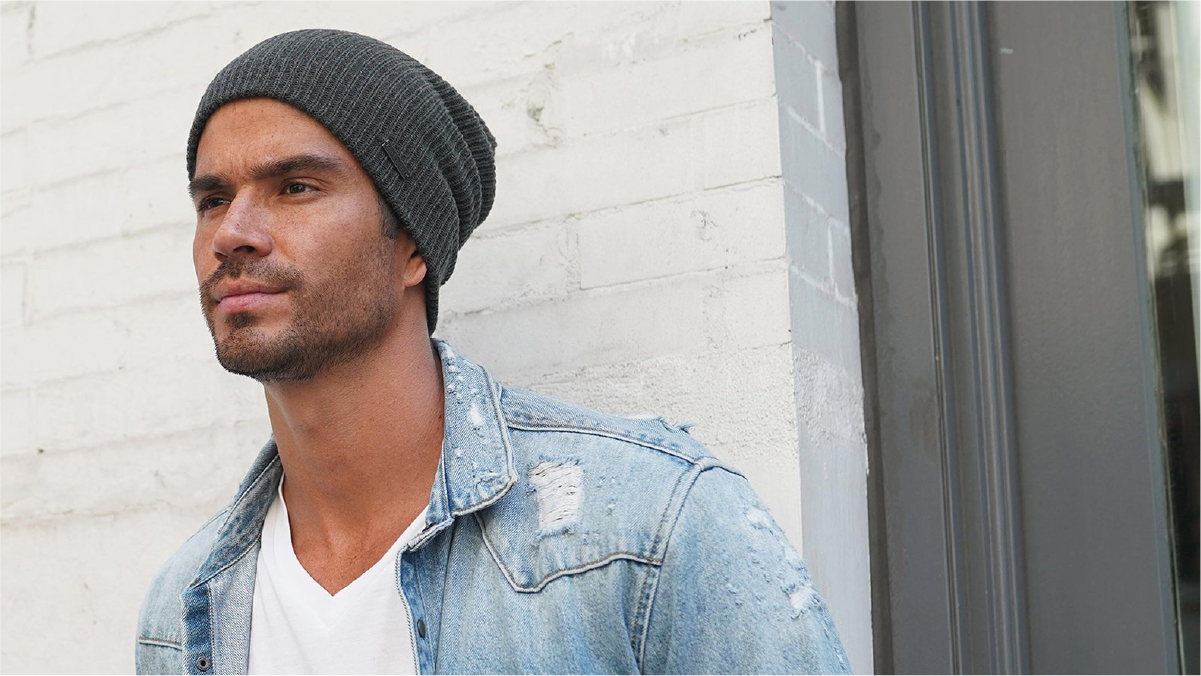 a guy with blue jacket and white t-shirt wearing a grey beanie hat