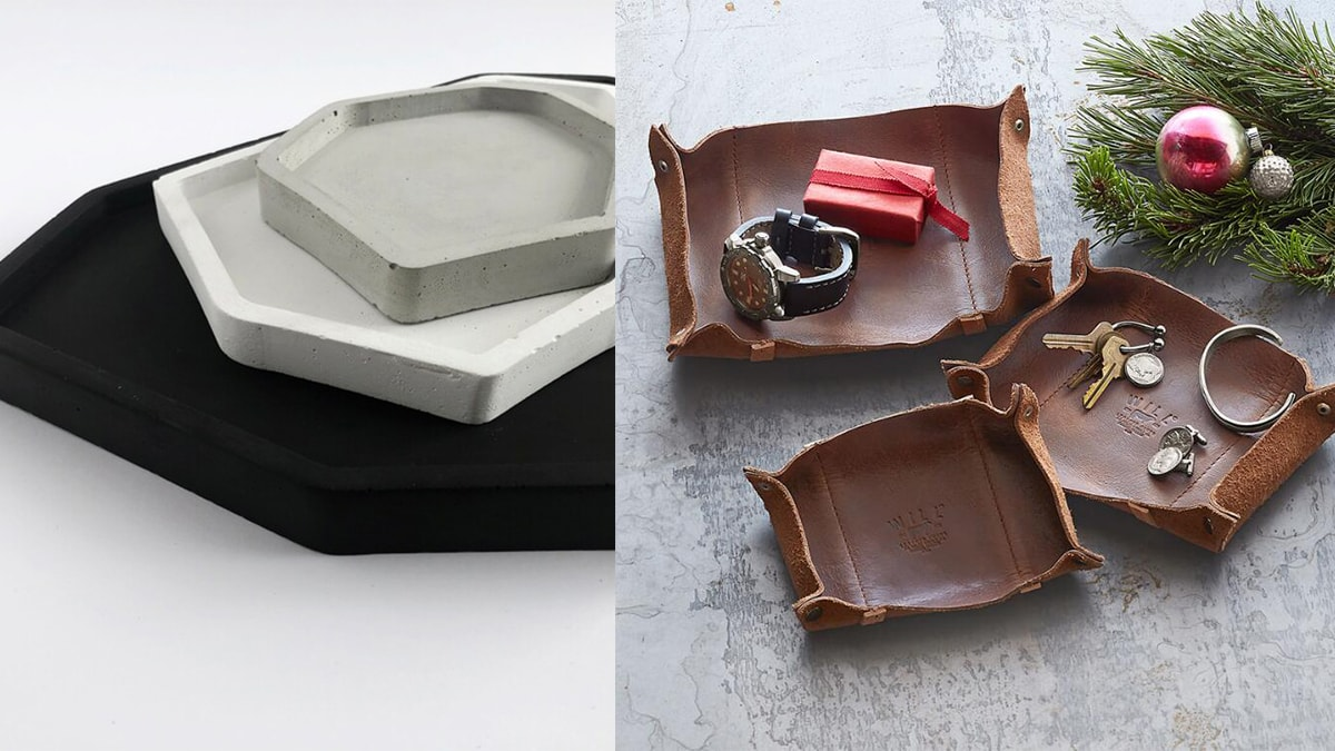 On left: black, and white catachall trays. On right, brown catchall trays with keys, timepiece, and a Christmas gift.