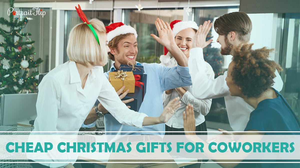 Cheap Christmas Gifts For Coworkers: Office colleagues are opening Christmas gifts and exchanging smiles.