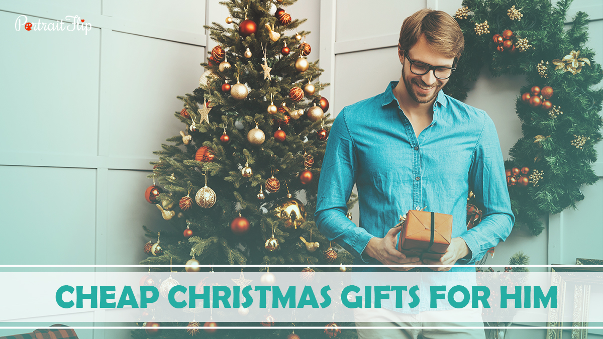 Cheap Christmas Gifts For Him: A man blushing while holding his Christmas gifts.