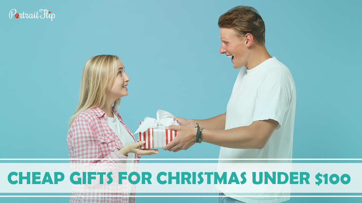 Cheap Gifts For Christmas Under $100: A boy is giving his girlfriend a surprise gift on Christmas.