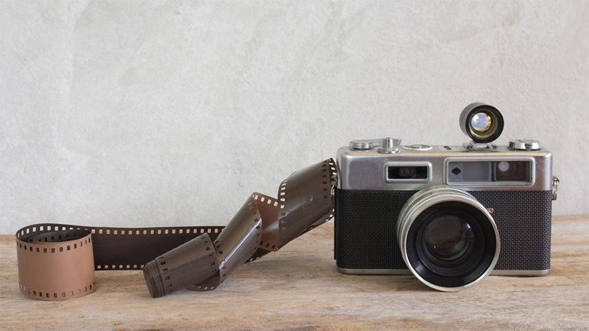 A Film Camera with a film roll on a table