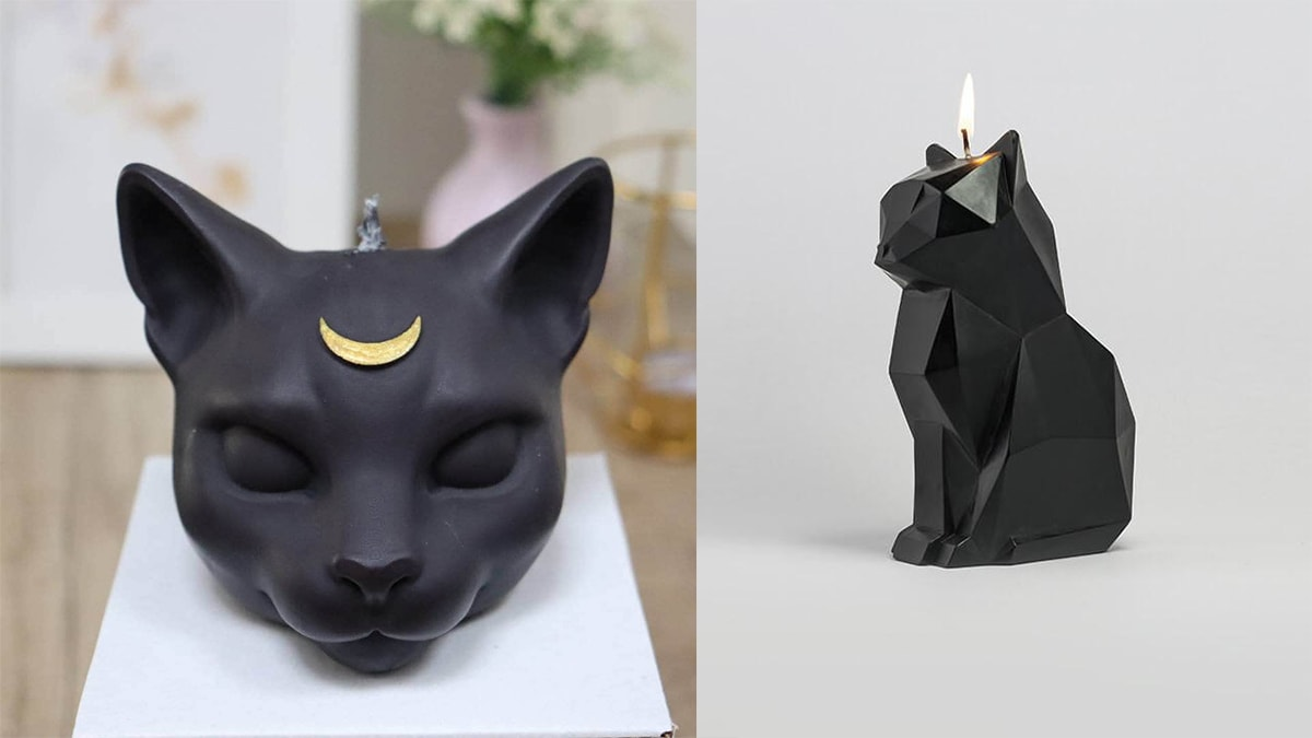 Two funky black cat candles.