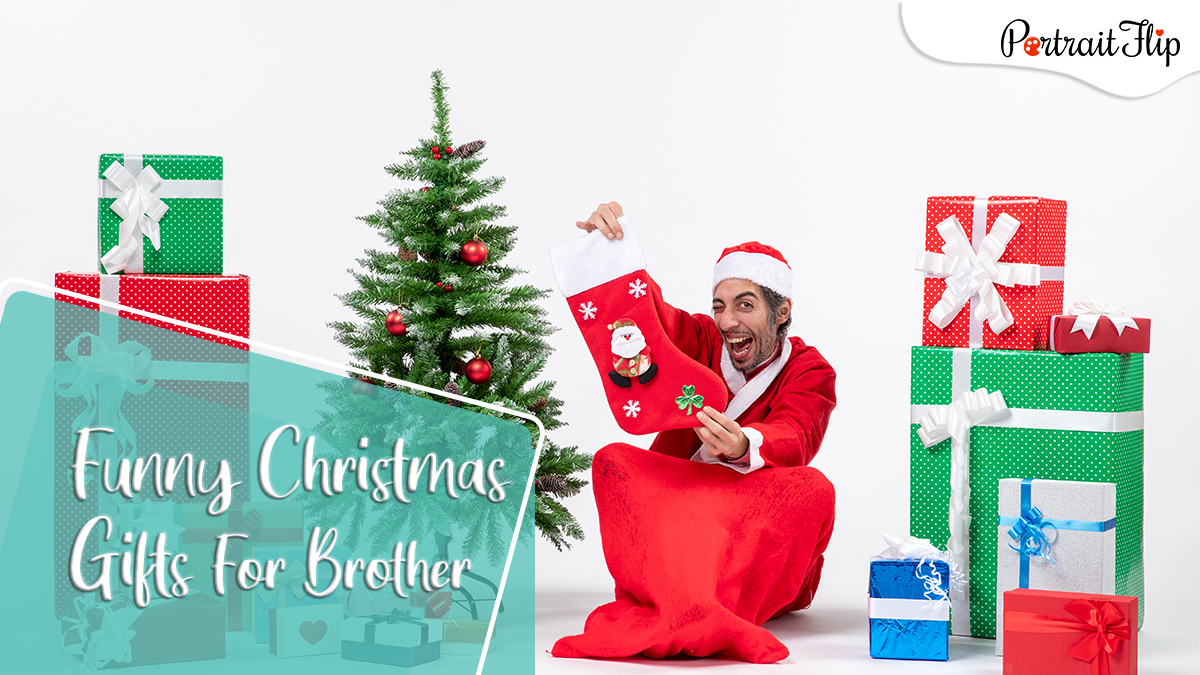 Funny christmas gifts Ideas for brothers: a guy posing as santa showing a big red sock and is grinning.