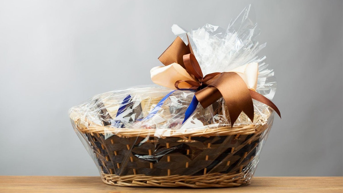 A gift hamper placed on wooden surface.