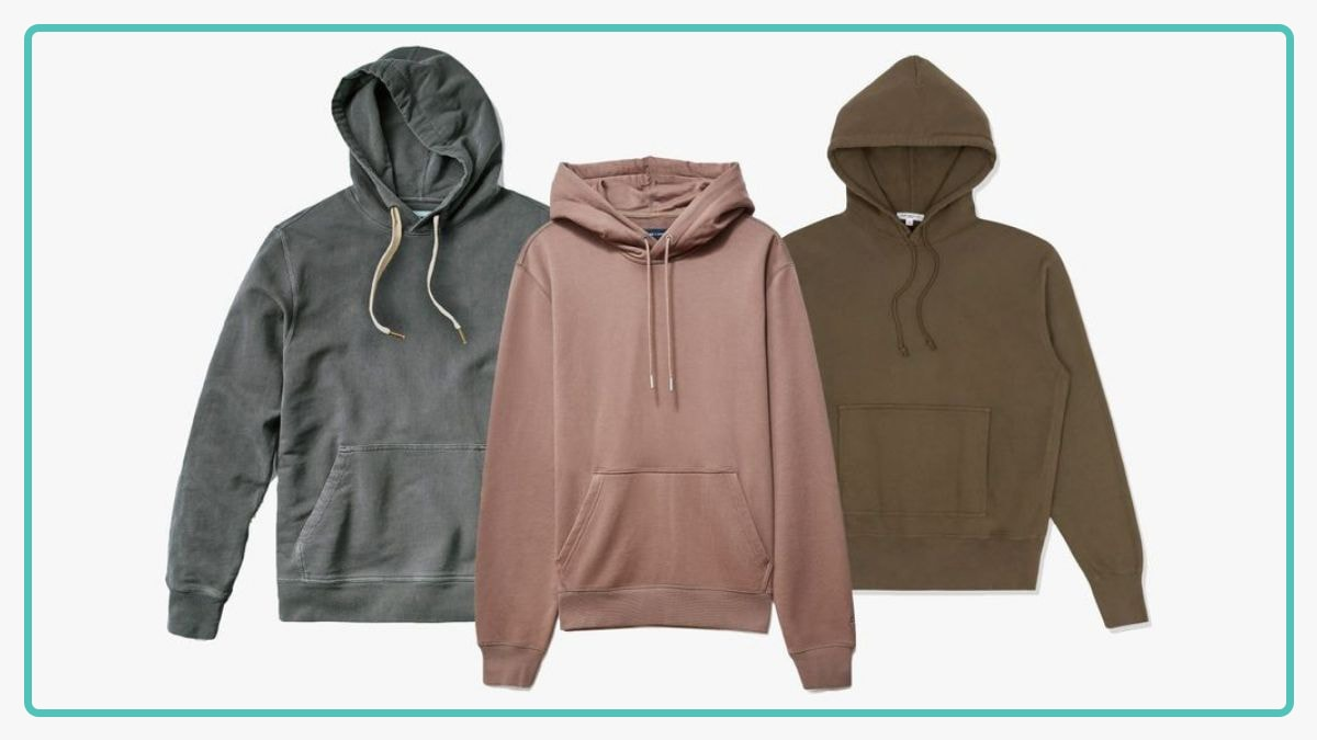 Grey, pink, and brown hoodies against a white background.