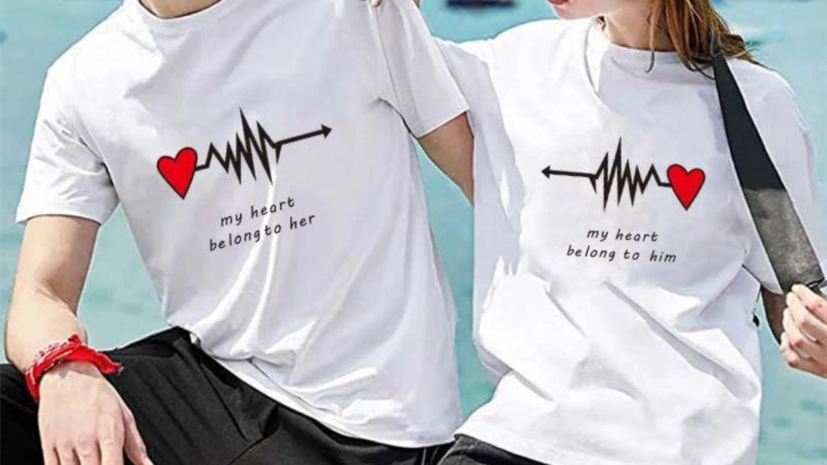 """two couples wearing matching t-shirts. On left: man's T-shirt has quote """"my heart belong to her"""". On right, the woman's t-shirt has a quote """"my heart belongs to him."""