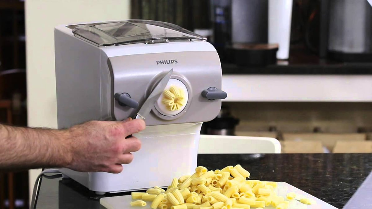 a guy making pasta from a Philips Pasta maker