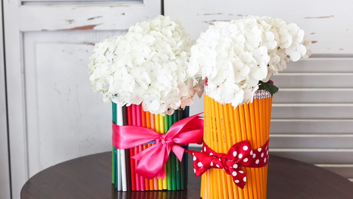 2 homemade Pencil Vases with beautiful white flowers