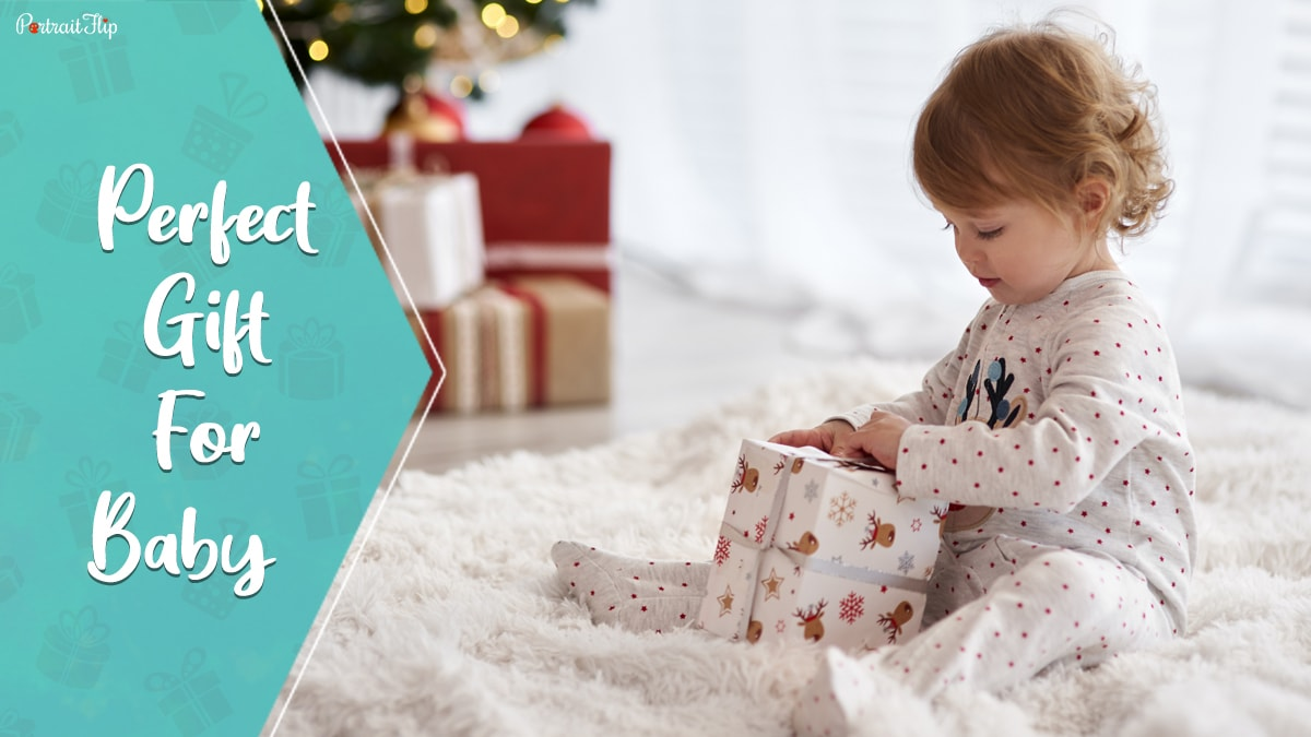 Perfect gifts for baby: a baby opening a gift.