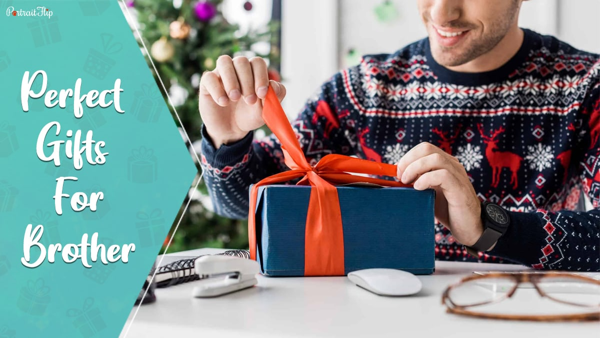 Perfect gifts for brother: A guy opening the ribbons of the gift that he'd received.