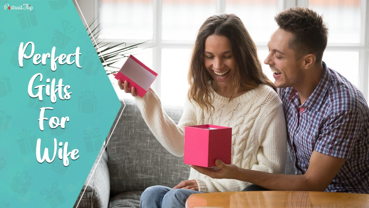 Perfect Gifts for wife: a wife happily opening a gift given by her husband.