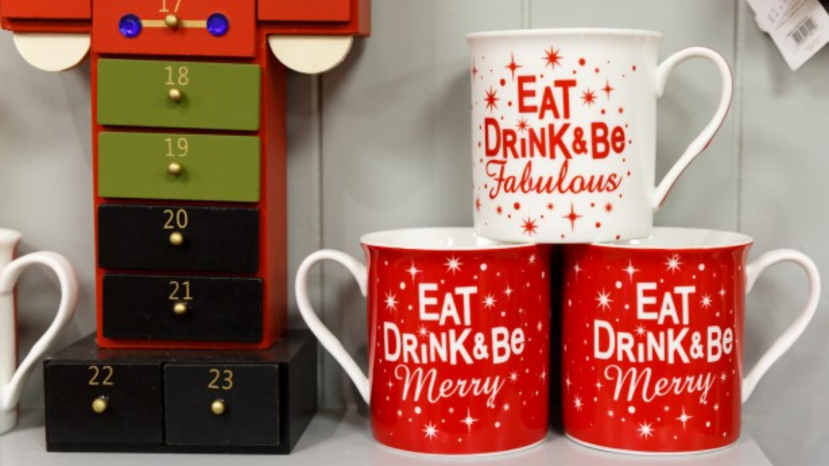 """Three Christmas mugs that have """"Christmas Quotes"""" written on their sides are placed on white surface."""