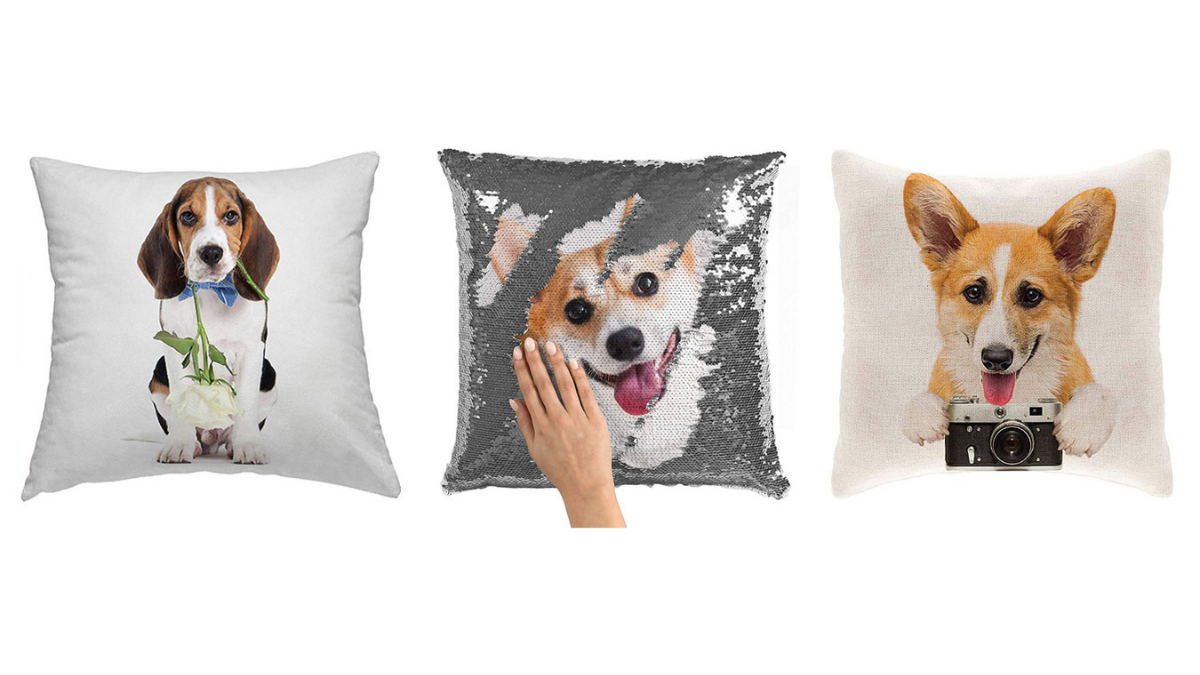 Pillows with three different dogs on them are placed on a white background.