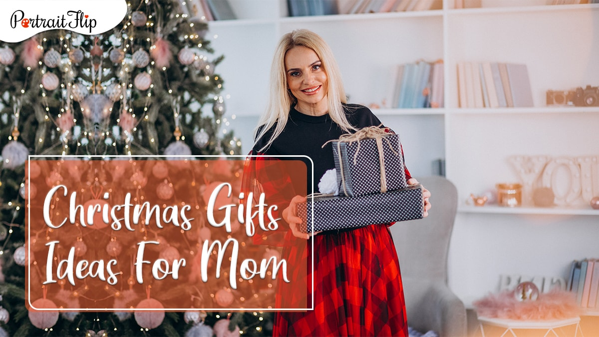 Christmas gifts for mom by portraitflip: a mom posing with gifts beside a Christmas tree
