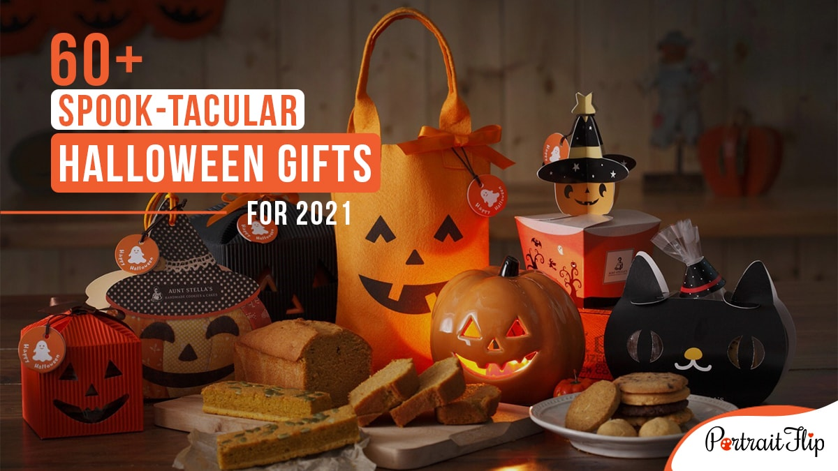 A table full of Halloween candies, treats, and gifts with a pumpkin lamp, with the words 60+ spook-tacular gifts written on the top left corner.