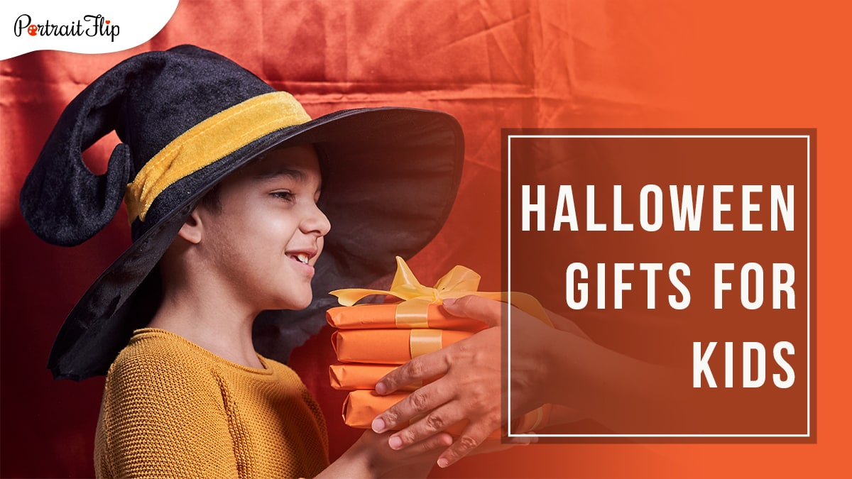 A orange satin backdrop with a kid in a black hat with yellow stripe accepting orange wrapped halloween gifts with yellow ribbons with Halloween Gifts for Kids written in a block on the right hand side