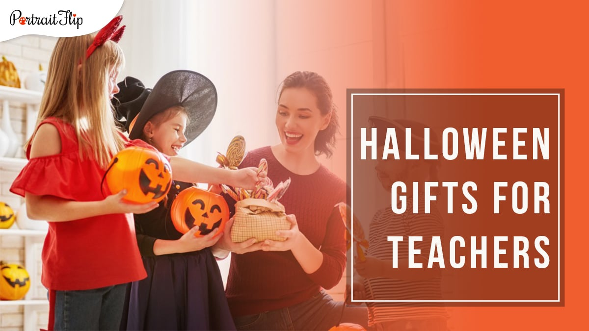 3 children collecting candied lollipops from the teacher's basket, which he is distributing while kneeling in front of a wall decorated with halloween pumpkins with Halloween Gifts for Teachers written in a box on the right hand side
