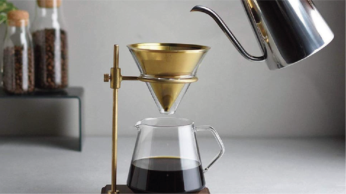 a person using pour-over coffee to make filtered coffee