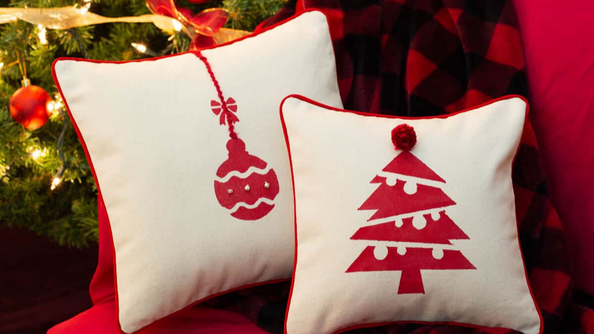 Two printable Christmas pillows are placed on the cushion bed.