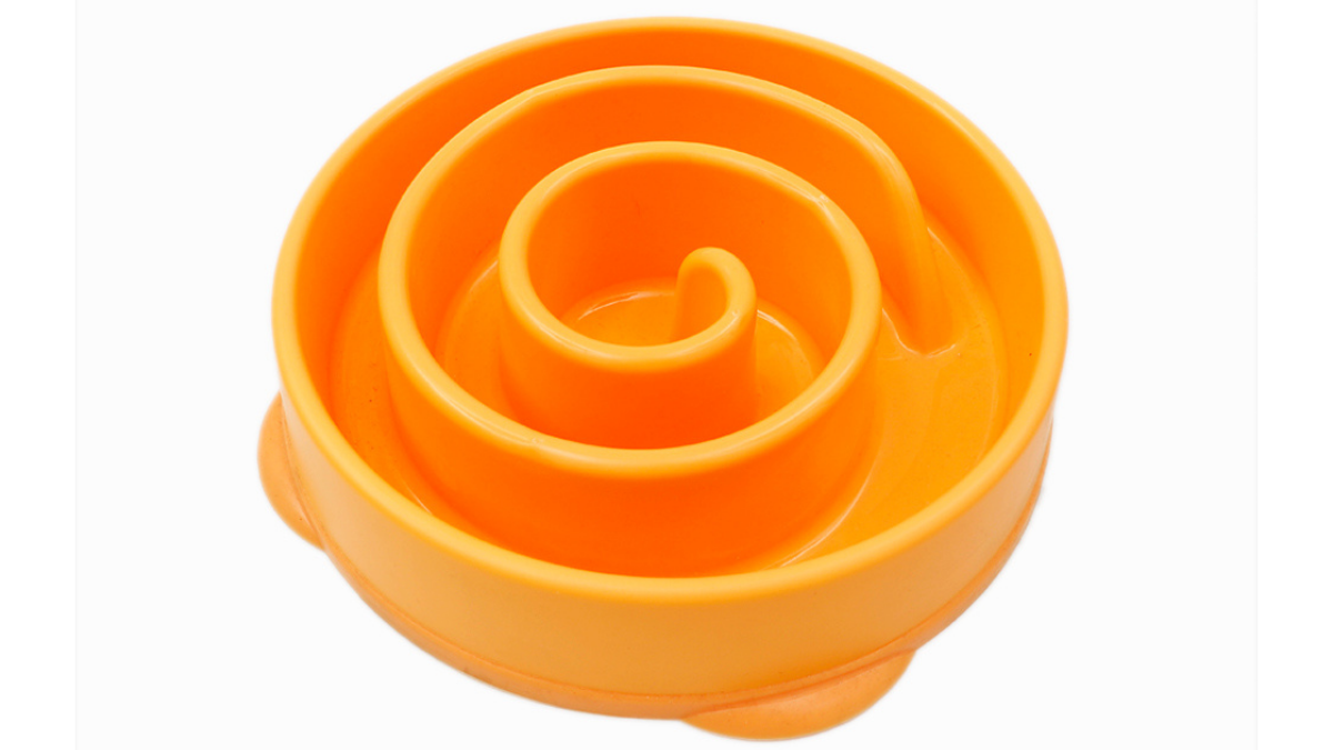 A orange colored slow bowl is placed on the white background.