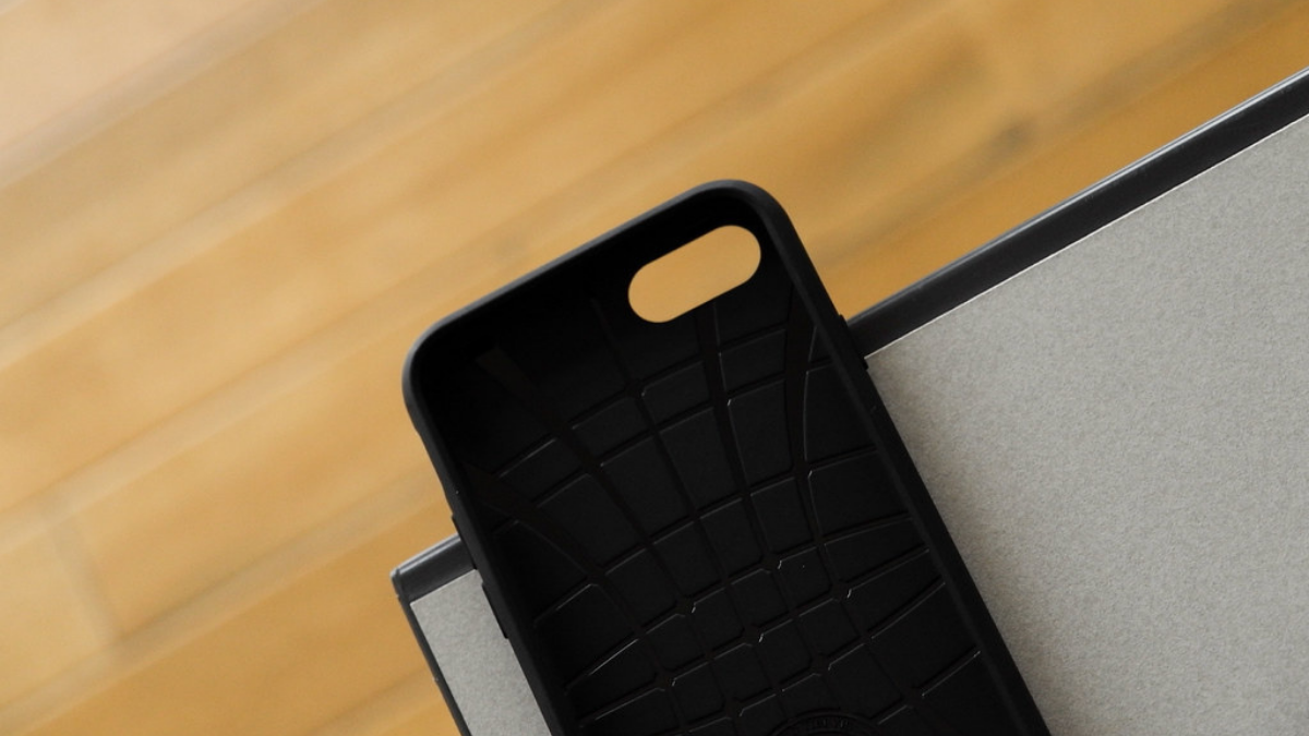 An elegant black back cover is placed on the brown background.