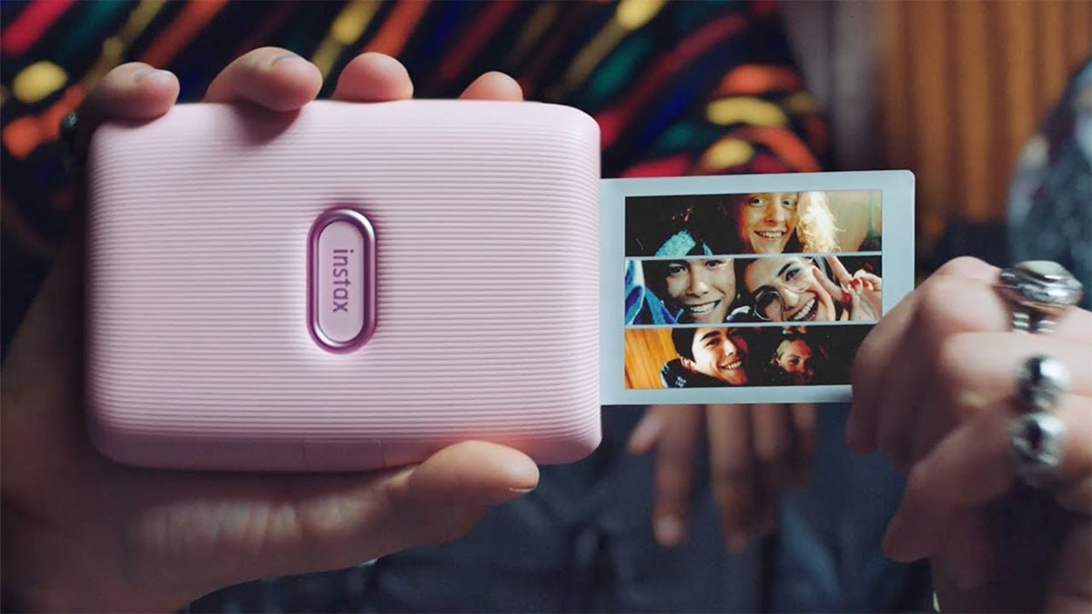 a compilation photo of friends being printed by a smartphone printer