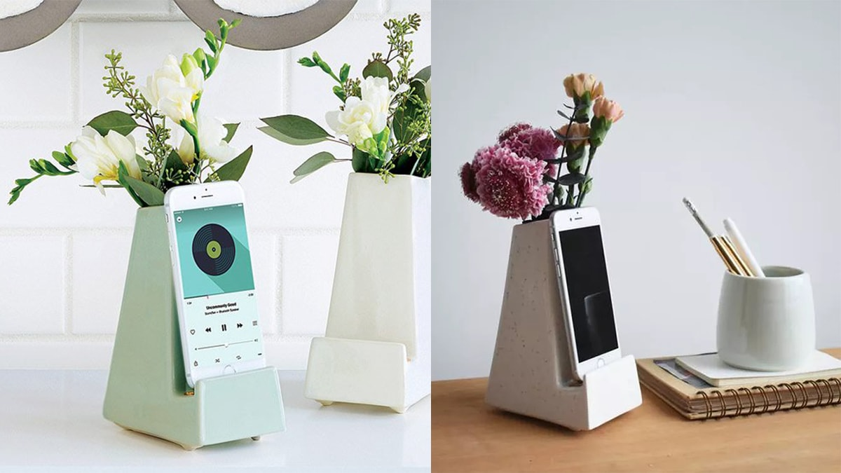 Smartphone vases with phones and beautiful flowers.