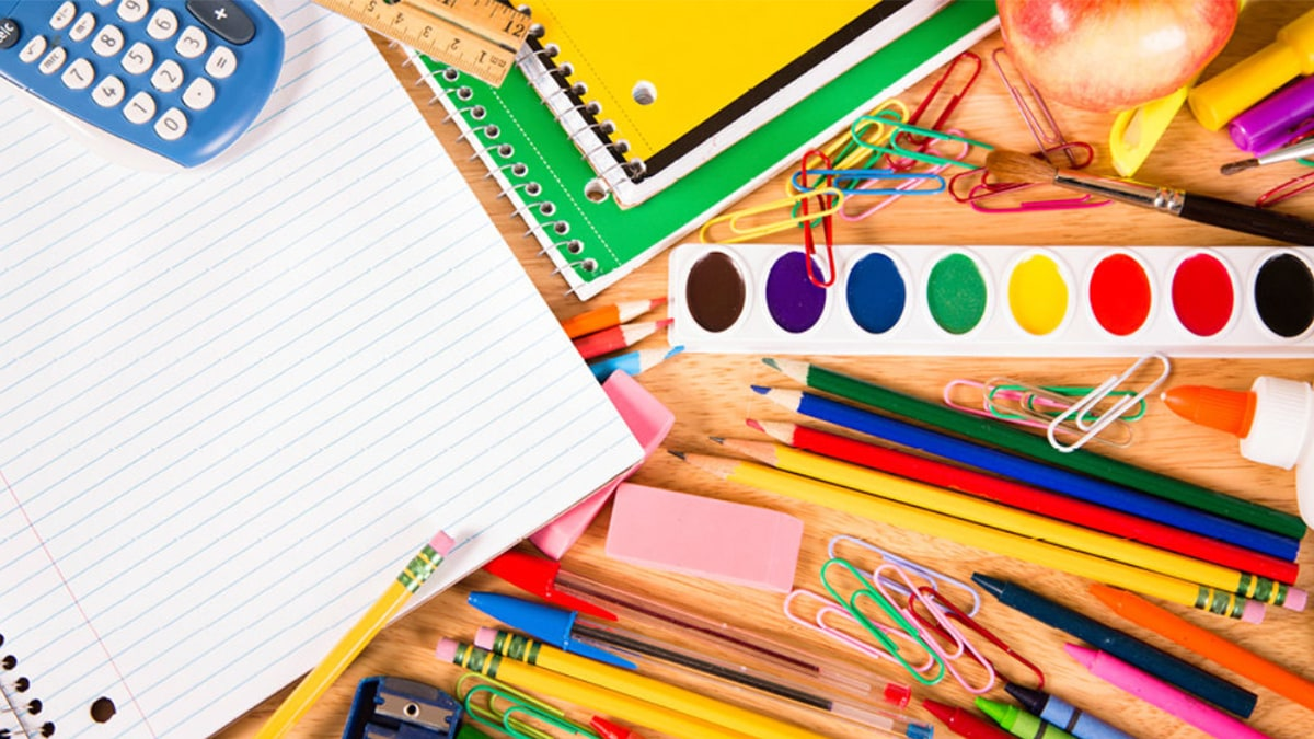 stationery set: papers, colored pencil, sketch pens, paper clips, pencils, eraser, watercolor cakes, glue, calculator, ruler, sharpener