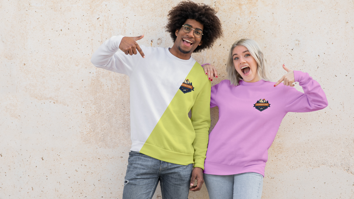 A boy in white and green and a girl in purple sweatshirts smiling in the front.