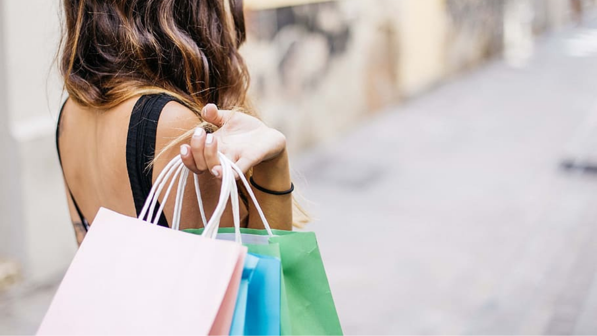 A girl carrying tote bags to shop for some products.