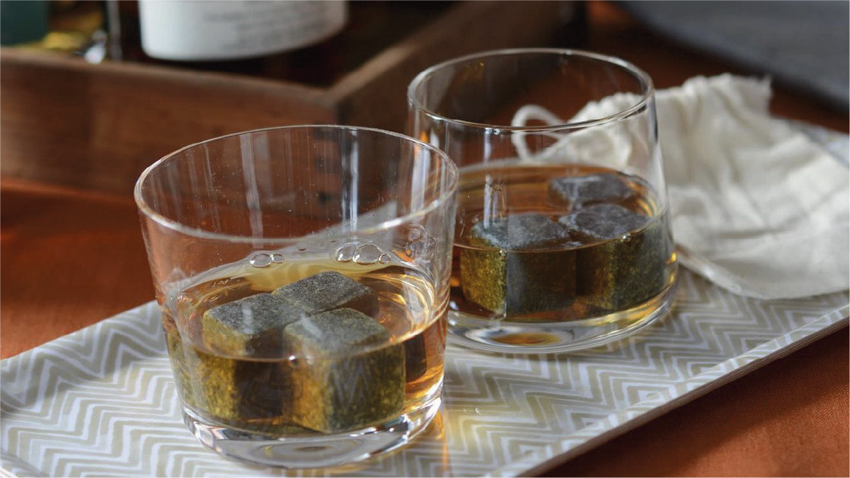 whiskey stones put in two different whiskey glasses