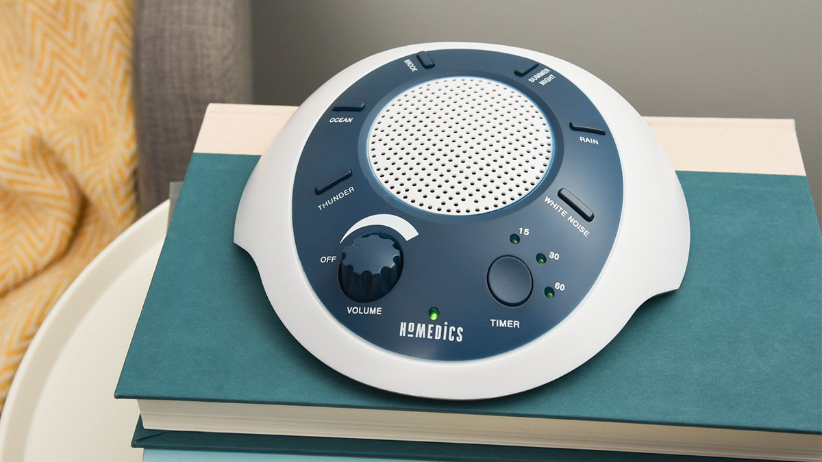 A White Noise Sound Machine kept on the side table