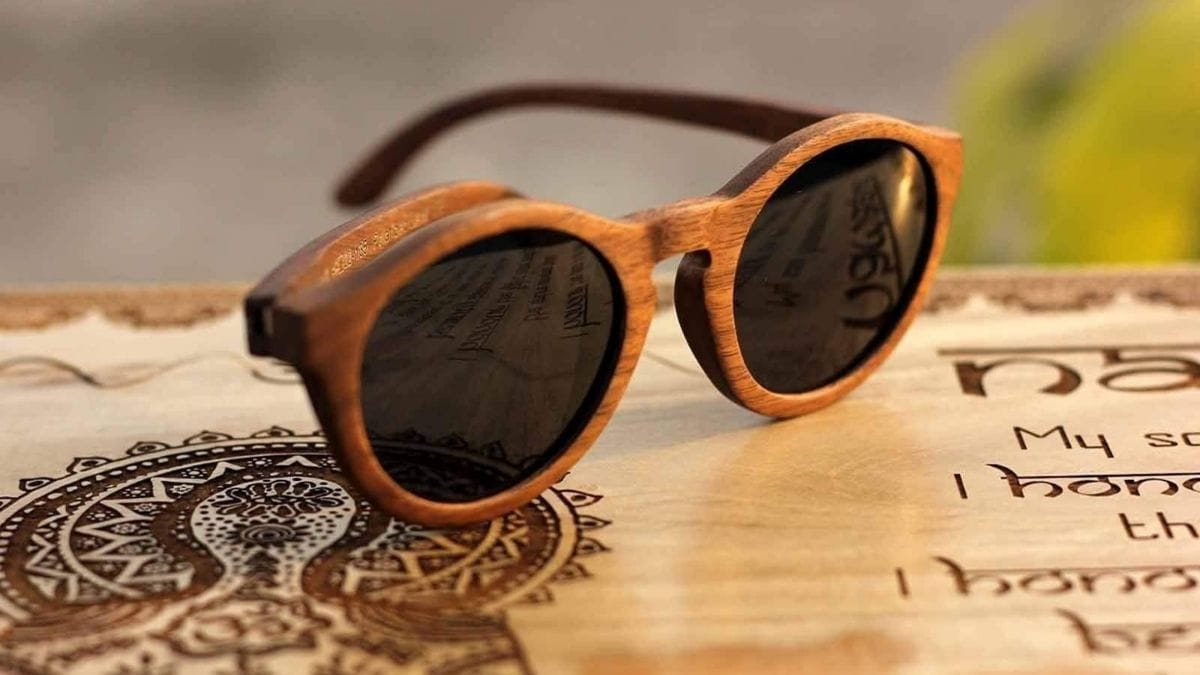 brown oval wooden sunglasses with black glasses