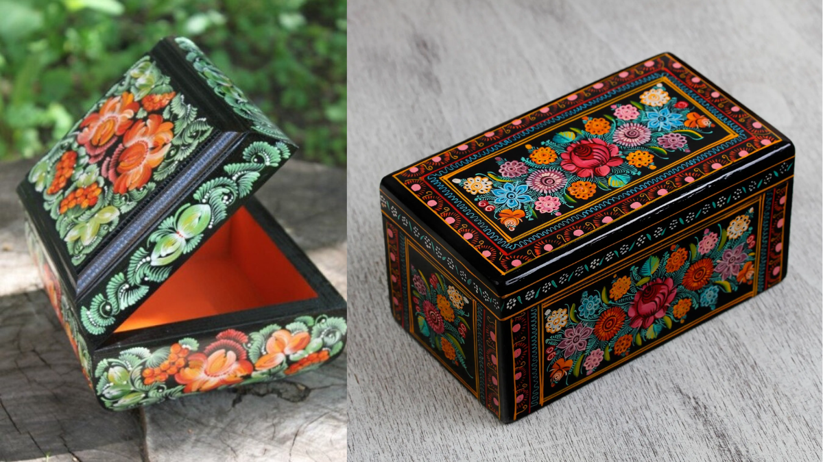 A beautiful box wooden box that is hand painted with colourful flowers. used to store things of value.