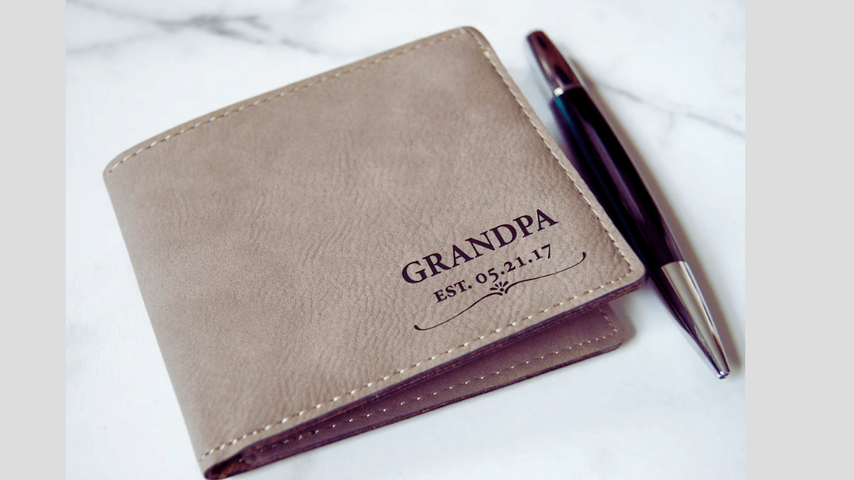 A personalized leather wallet, engraved with the words grandpa and the date he became a grandpa. this sentimental gift is perfect christmas gift idea.