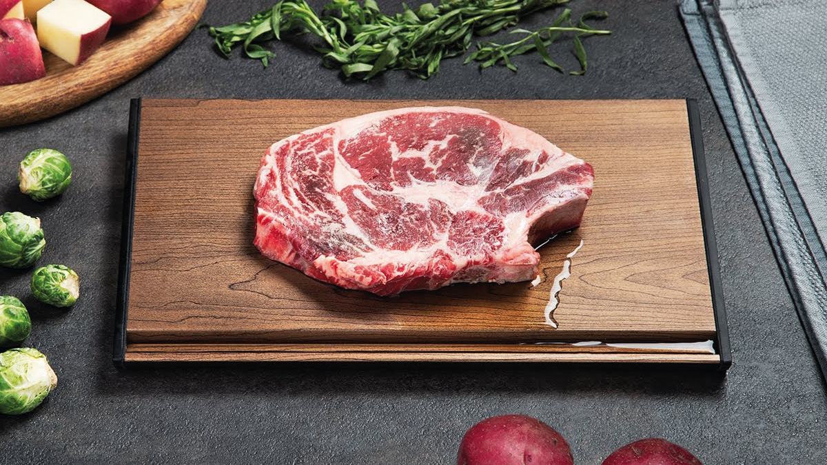 a huge chunk of meat getting defrosted on a Defrosting tray