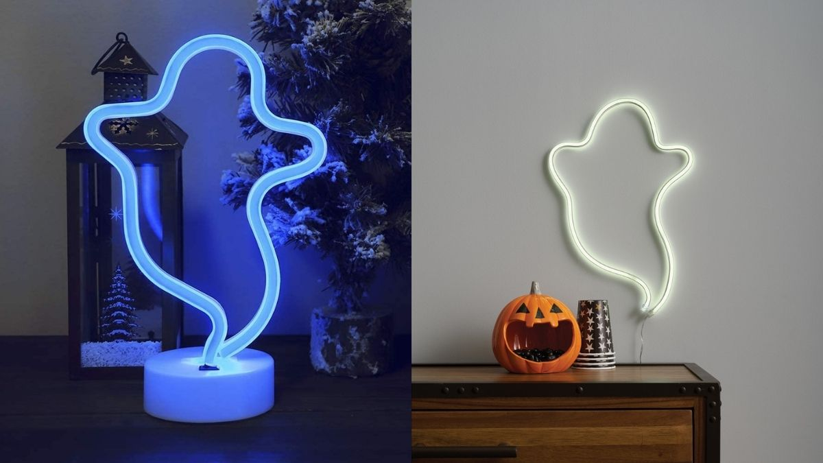 a ghost outlined blue LED lamp kept on a table on the left and on the right a wall decorated with a ghost outlined white LED lamp with halloween day decoration under it.