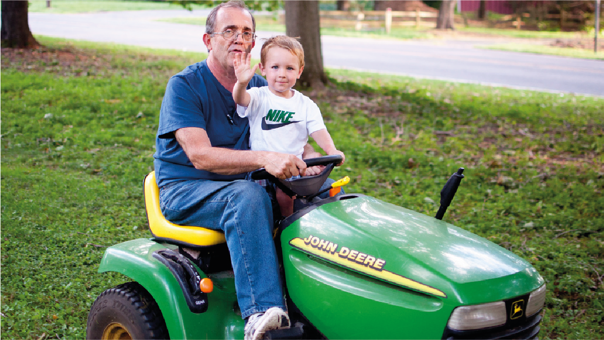 A grandpa who is passionate about his lawn, get a new lawnmower and is enjoying mowing his awn with his grandson. A this an amazing Christmas gifts ideas for grandpa.