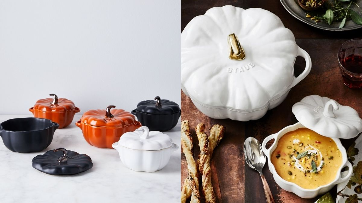 Pumpkin shaped cast iron cocottes in different sizes by Staub. An open cocotte displayed on the table for Halloween dinner with pumpkin soup in it.