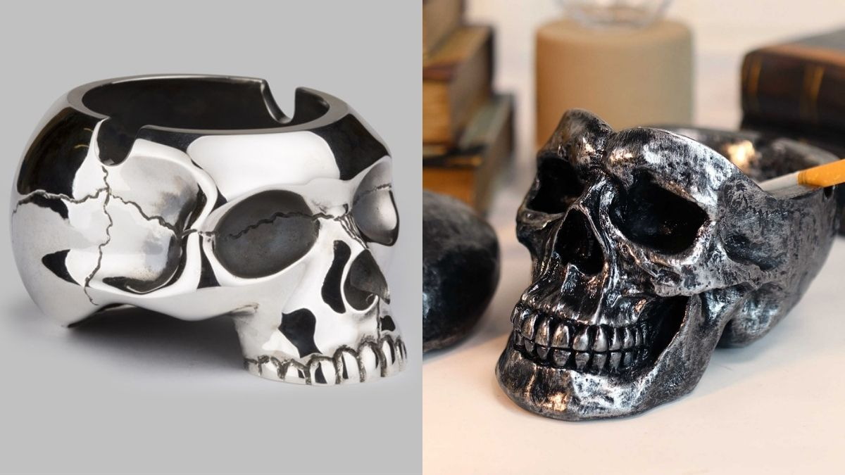 Oxidized and Silver colored ashtrays in the shapes of skulls with a stubbed cigarette in the oxidized skull ashtray as a Halloween present.